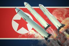 Launch of nuclear missiles. North Korean flag in background. 3D rendered illustration Stock Image