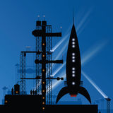Launch Pad. A retro cartoon rocket at night on a launch pad preparing to take off Royalty Free Stock Photography