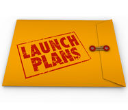 Launch Plans Yellow Envelope Start New Business Company Secrets. Launch Plans words stamped in red ink on yellow envelope offering advice, information, steps and Stock Photography