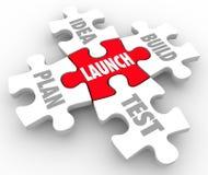 Launch Puzzle Pieces Idea Build Plan Test Starting New Business. Launch puzzle pieces start new business steps including words Idea, Build, Plan and Test Royalty Free Stock Photos