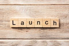 Launch word written on wood block. launch text on table, concept.  royalty free stock photography