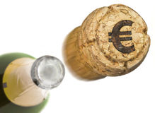 Launched champagne cork with the shape of a Euro symbol burnt in Stock Photo