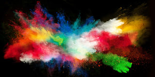 Launched colorful powder on black background stock photos