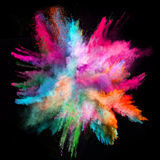 Launched colorful powder on black background. Launched colorful powder, isolated on black background stock photos