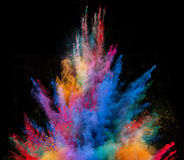 Launched colorful powder on black background. Launched colorful powder, isolated on black background royalty free stock photography