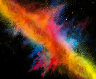 Launched colorful powder on black background. Launched colorful powder, isolated on black background stock images