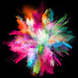 Launched colorful powder on black background. Launched colorful powder, isolated on black background stock photography