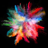 Launched colorful powder on black background. Launched colorful powder, isolated on black background royalty free stock images