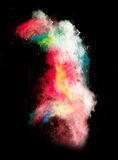 Launched colorful powder. Isolated on black background royalty free stock image