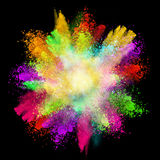 Launched colorful powder. Isolated on black background stock image
