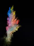 Launched colorful powder. Isolated on black background stock photography