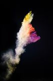 Launched colorful powder. Isolated on black background royalty free stock photo