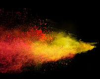 Launched colorful powder over black. Launched colorful powder, isolated on black background stock images