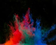 Launched colorful powder over black Royalty Free Stock Photo
