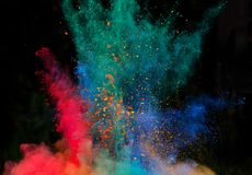 Launched colorful powder over black Stock Images