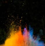 Launched colorful powder over black Stock Photography