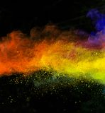 Launched colorful powder over black Stock Photos