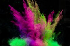 Launched colorful powder over black. Launched colorful powder, isolated on black background stock photography