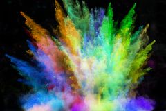 Launched colorful powder over black Royalty Free Stock Photos