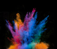 Launched colorful powder over black. Launched colorful powder, isolated on black background royalty free stock image