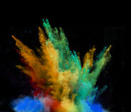 Launched colorful powder over black Royalty Free Stock Photography