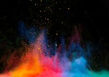 Launched colorful powder over black Stock Image