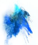 Launched colorful powder over white Royalty Free Stock Images