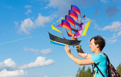 Launches ship kite. MOSCOW - AUGUST 30, 2015: Unidentified man launches ship kite to the sky in Tsaritsyno Park on August 30, 2015 in Moscow Stock Photography