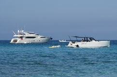 Launches and yachts moored off on a blue sea Stock Photos