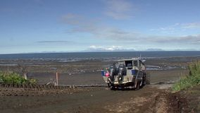 Launching a boat in the sea in Alaska stock video footage