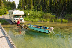 Launching a fishing boat in the yukon territories Royalty Free Stock Images