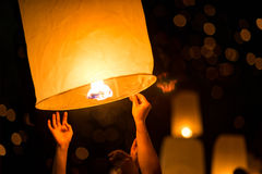 Launching hot air sky lantern Stock Image