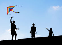 Launching a kite in the sky Royalty Free Stock Image