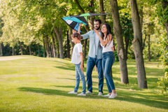 Launching kite while spending time together in park Stock Photo