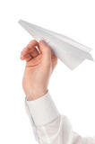 Launching paper airplane Stock Photo