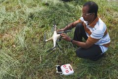 Launching quadcopter in park Royalty Free Stock Photo