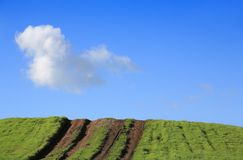 Launching ramp to the sky. Dirt tracks up the hill, sloping upward to the sky Royalty Free Stock Photo