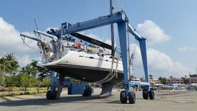 Launching sailing yacht at Phuket boat lagoon shipyard Stock Image