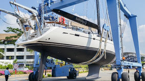 Launching sailing yacht at Phuket Boat lagoon Thailand Stock Images