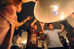Launching sky lanterns Royalty Free Stock Image
