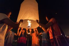 Launching sky lanterns Stock Photo