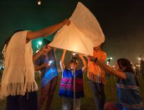Launching sky lanterns Royalty Free Stock Images
