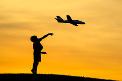 Launching a toy plane. Royalty Free Stock Photos