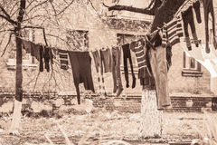 Launder clothes. Drying in the sun in the courtyard Stock Images