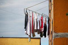 Laundered clothes drying outside Stock Photos