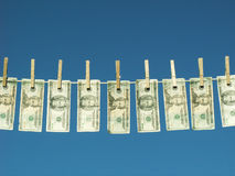 Laundered money. American twenty dollar bills hung on a clothesline royalty free stock photo