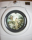 Laundering Money. It is not just about clean money.  The criminal way of laundering money is a bit different, but this image gets the point across Stock Photography