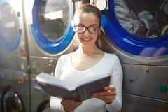 Laundress reading Royalty Free Stock Photo