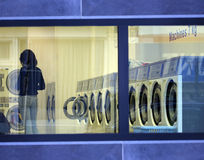 Laundromat. View through a laundromat window in the evening stock photos