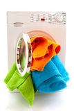 Laundromat. With colorful laundry isolated over white royalty free stock photos